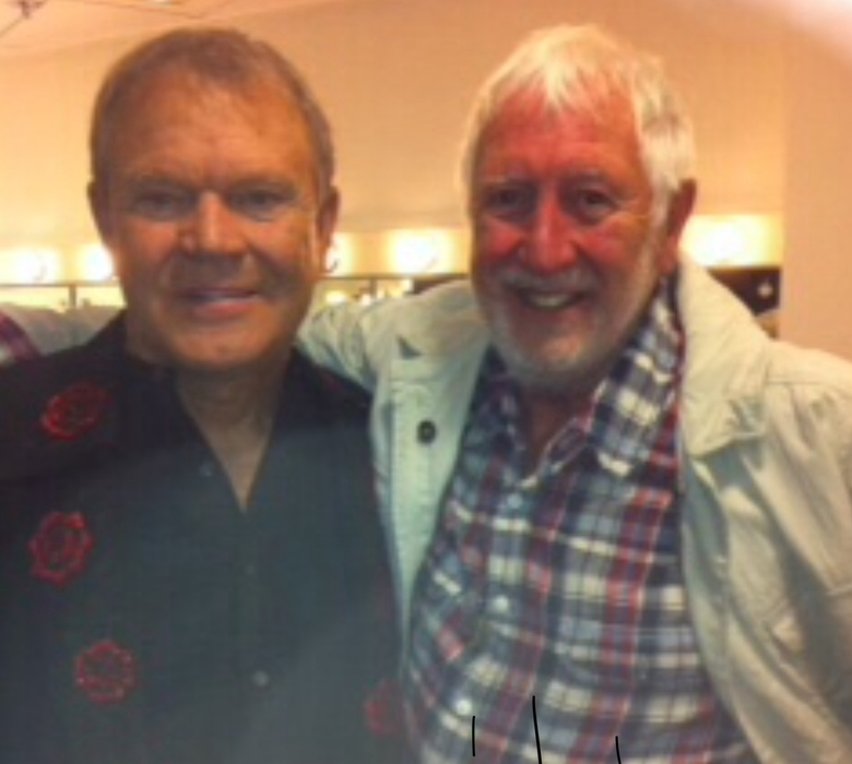 A really good friend of Phil and I —— recorded a fab version of Bowling Green. This pic was taken of Glen and I on his farewell tour in UK —RIP. A wonderful man Cheers Terry Slater.